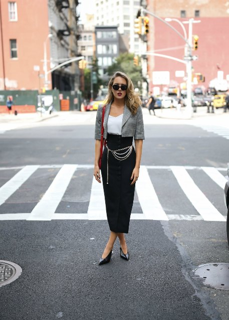 With white top, maxi skirt, black shoes and red bag