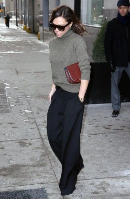 wide black pants, a grey green turtleneck sweater for a chic and minimalist work look