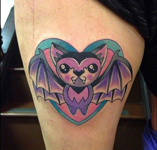 Pink and purple cartoon bat tattoo on the leg