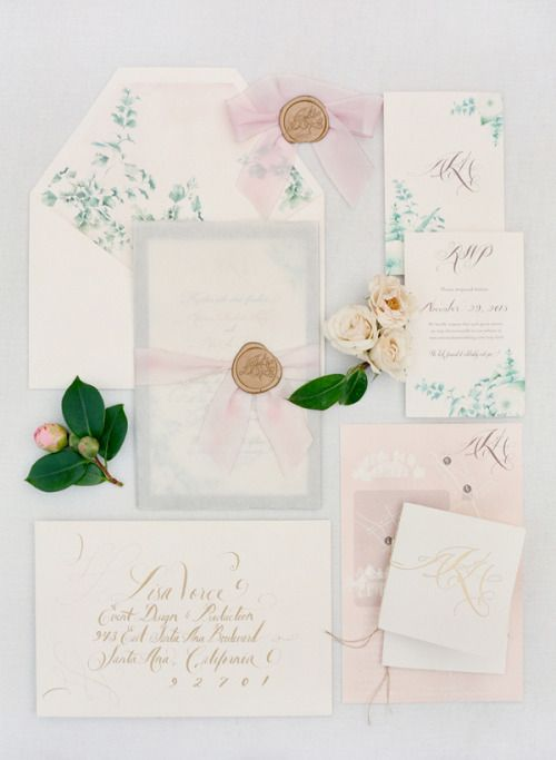 a creamy, blush and light grey wedding stationery set with a botanical print on the lining