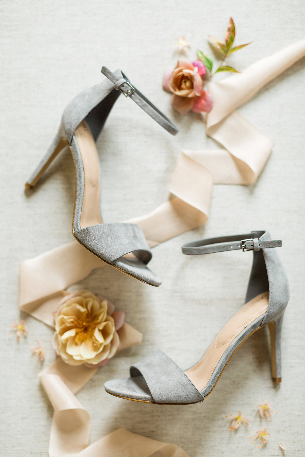 romantic grey wedding shoes - https://ruffledblog.com/cloudy-day-wedding-inspiration-with-a-hand-painted-bridal-gown