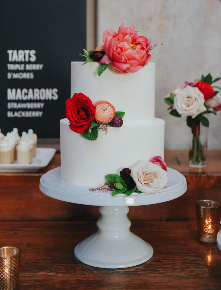 The wedding cake was a simple white one with various blooms