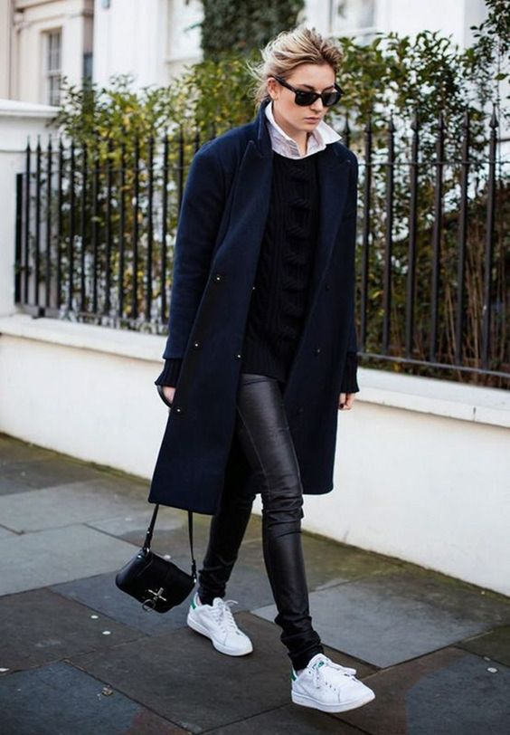 a black leather leggings, white sneakers, a black swetaer and a navy coat
