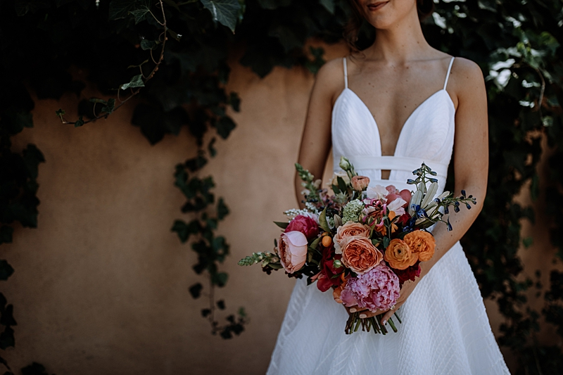 pink and orange wedding bouquets - http://ruffledblog.com/laid-back-los-poblanos-wedding-with-orange-bridesmaid-gowns