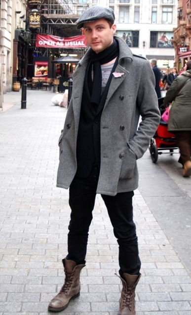 With tweed coat, black scarf, black pants and boots