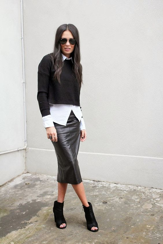 a black leather midi, a white shirt, a black cropped sweater, black peep toe booties