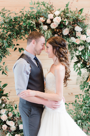 Floral wreath wedding ceremony backdrop