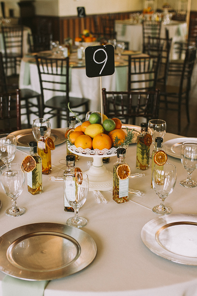 The table decor was done with vintage stands and citrus and citrus-flavored oil was given as favors