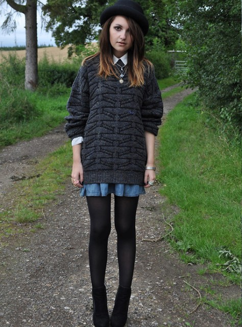 With oversized sweater, denim mini skirt, black tights and ankle boots