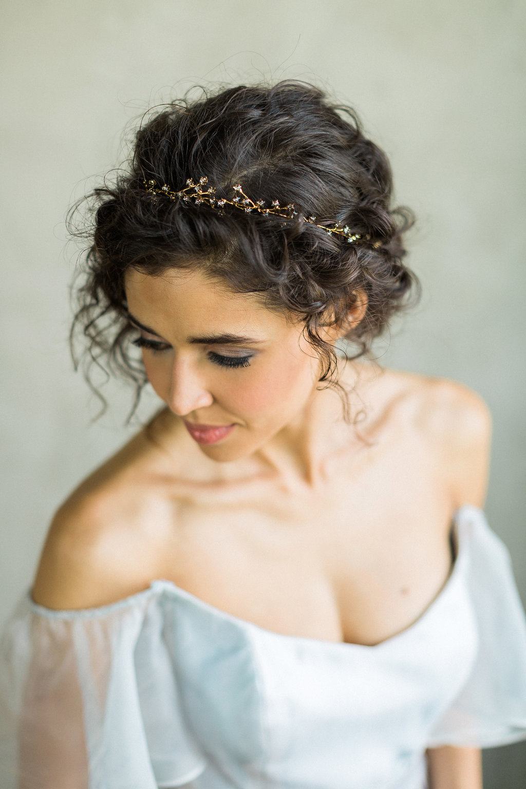 delicate bridal hair accessories - https://ruffledblog.com/cloudy-day-wedding-inspiration-with-a-hand-painted-bridal-gown