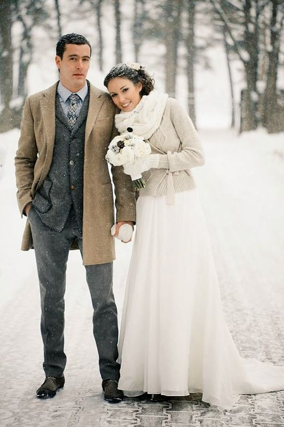 a neutral sweater and a white cable knit scarf for an elegant bridal look
