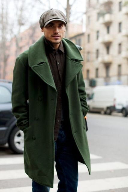 With green coat, brown shirt and jeans