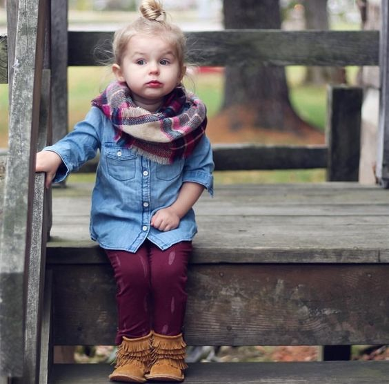 thanksgiving outfit with a chambray shirt, burgundy pants, a plaid infinity scarf and brown suede booties