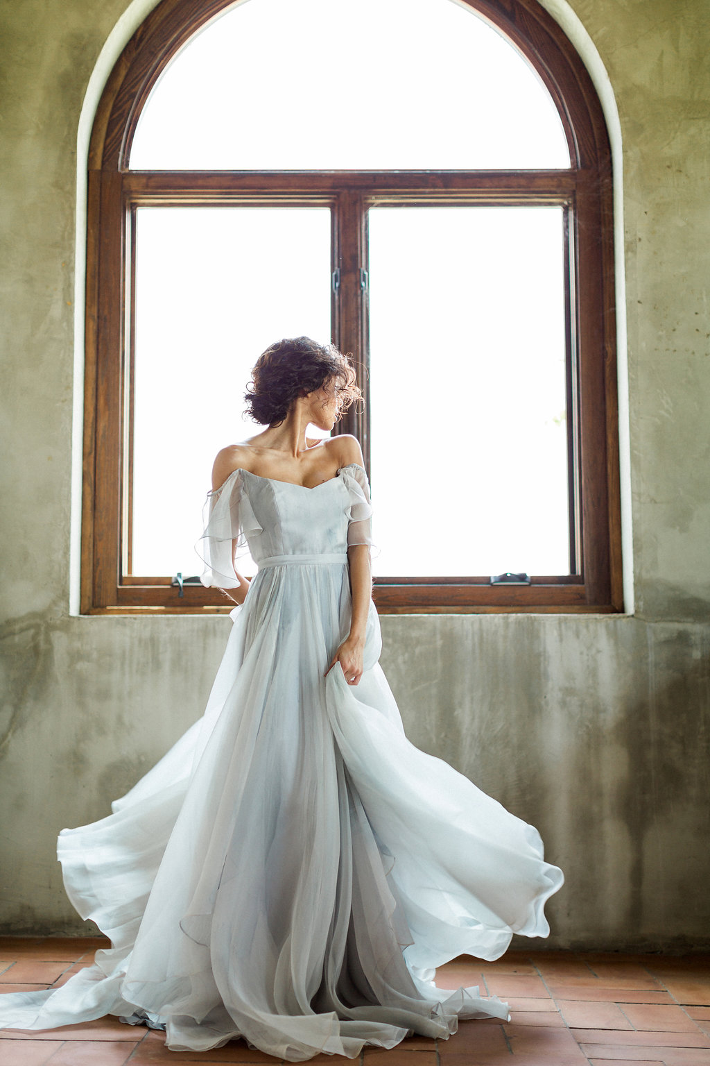 blue handpainted wedding gowns by Leanne Marshall - https://ruffledblog.com/cloudy-day-wedding-inspiration-with-a-hand-painted-bridal-gown