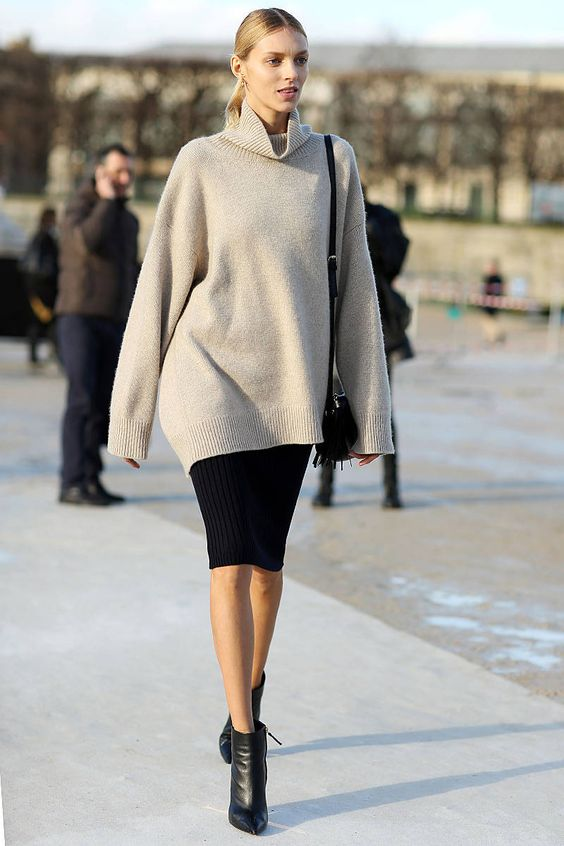 black leather booties, a black pencil skirt and a neutral oversized sweater