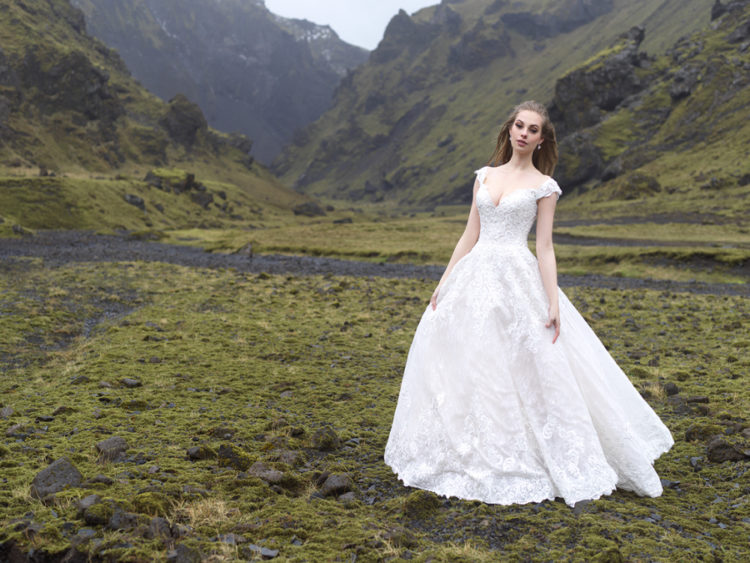 An off the shoulder wedding gown with textural lace and A-line looks princess-like
