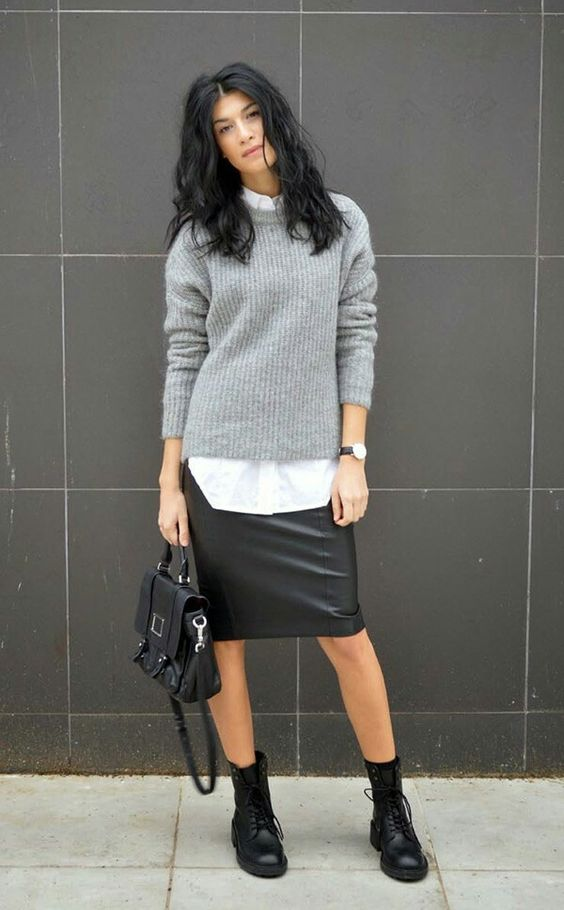 a white shirt, a grey sweater, a black leather knee skirt and boots for a creative and relaxed work look