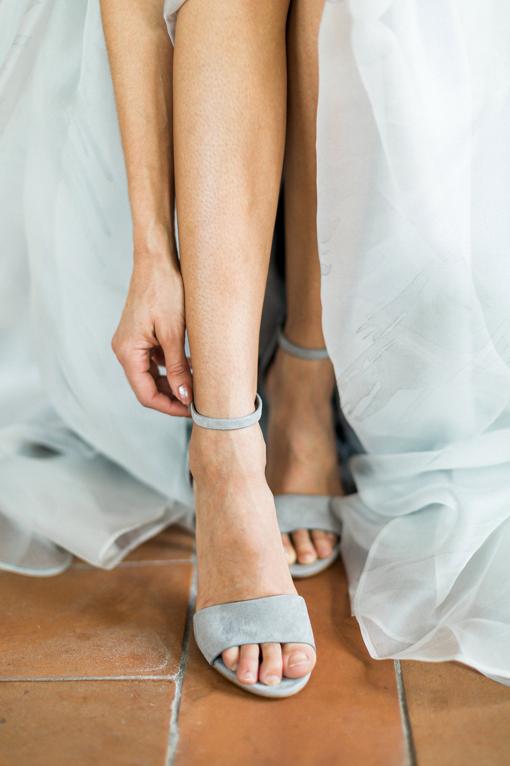 blue suede wedding shoes - https://ruffledblog.com/cloudy-day-wedding-inspiration-with-a-hand-painted-bridal-gown