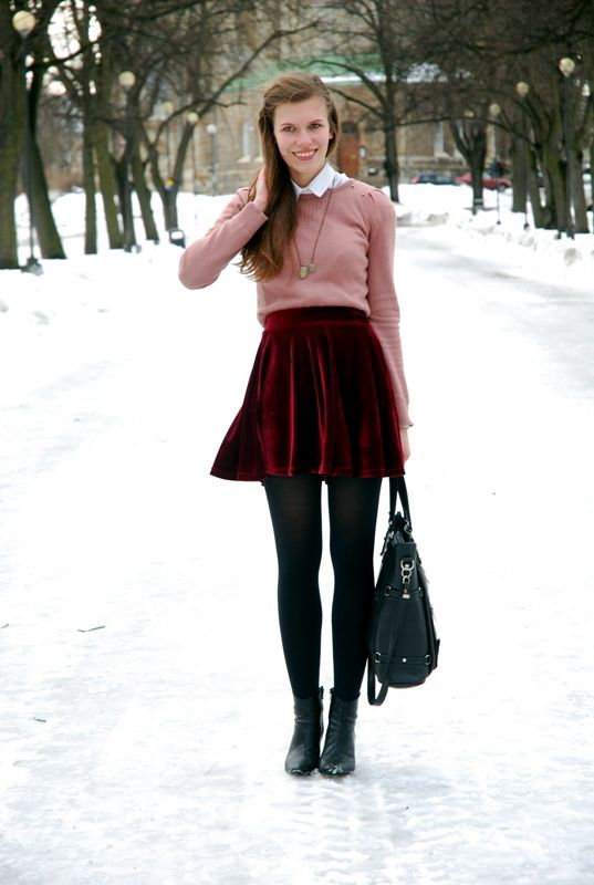 a pink sweater, a white shirt, a red velvet mini skirt, black tights and black booties