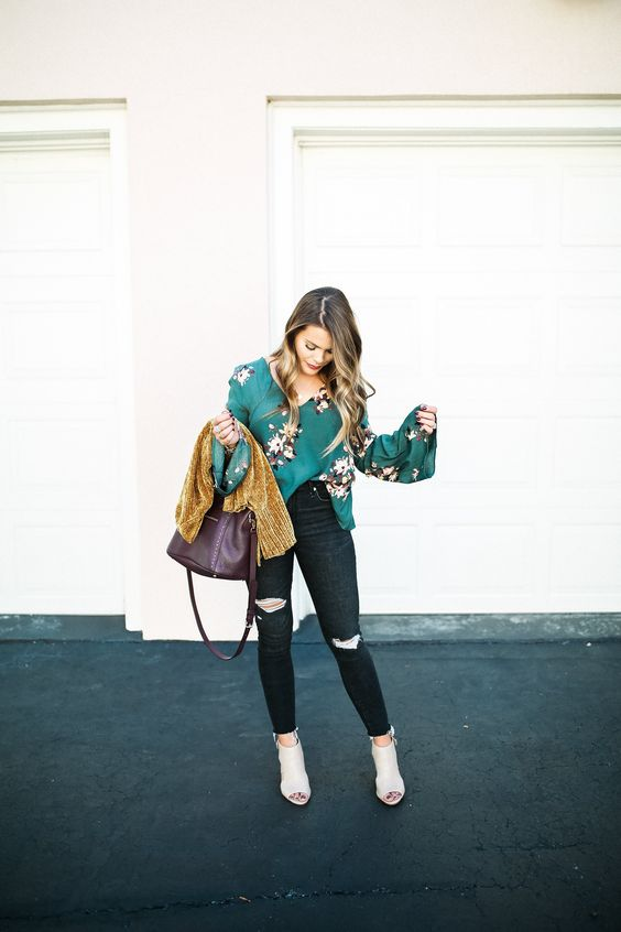 black ripped jeans, an emerald floral shirt, a mustard cardigan and neutral peep toe booties