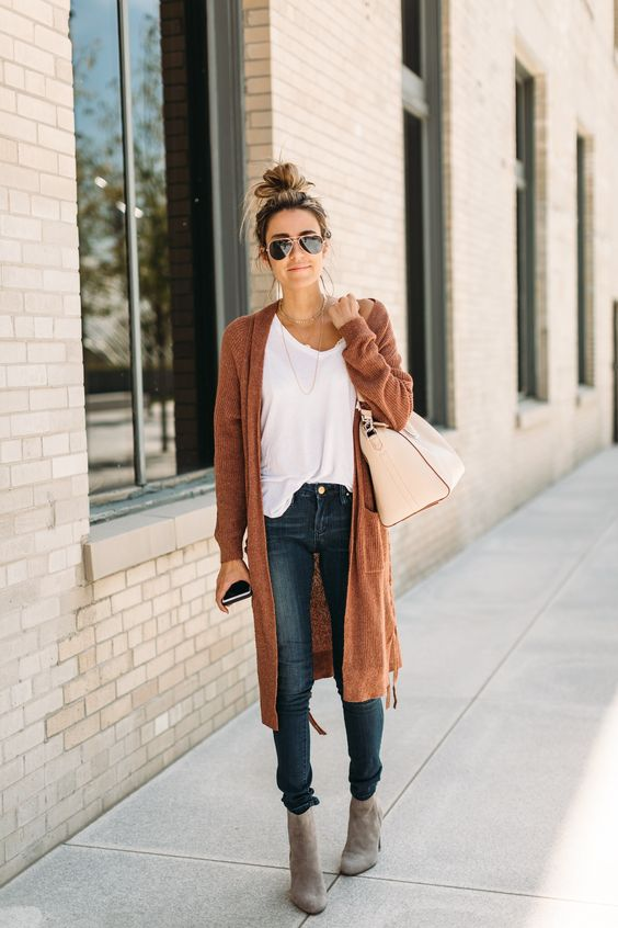 blue skinnies, a white tee, grey suede booties, a burnt orange cardigan for a comfy look