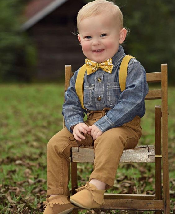 amber jeans and booties, a chambray shirt, mustard suspenders and a bow tie for a vintage look