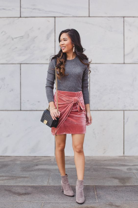 a grey sweater, a pink bow velvet mini, suede brown booties