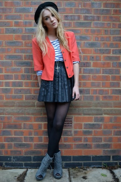 With striped shirt, orange blazer, mini skirt and cutout boots