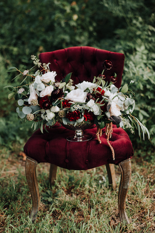 Burgundy, white, and green centerpiece