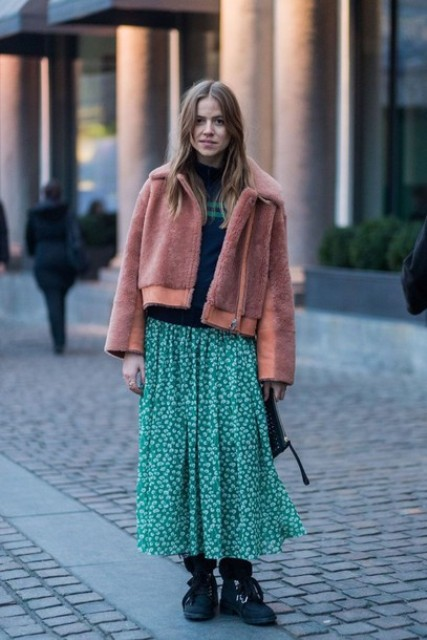 With striped sweater, printed maxi skirt, flat boots and clutch