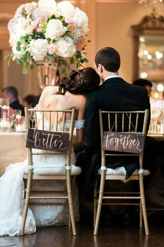 dark stained signs with calligraphy are great for accentuating your wedding chairs