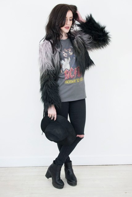 With printed t-shirt, jeans, platform boots and hat