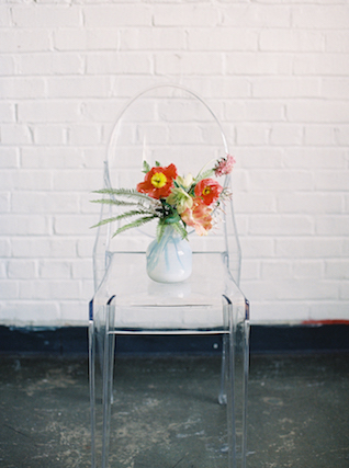Hand blown glass vase on ghost chair