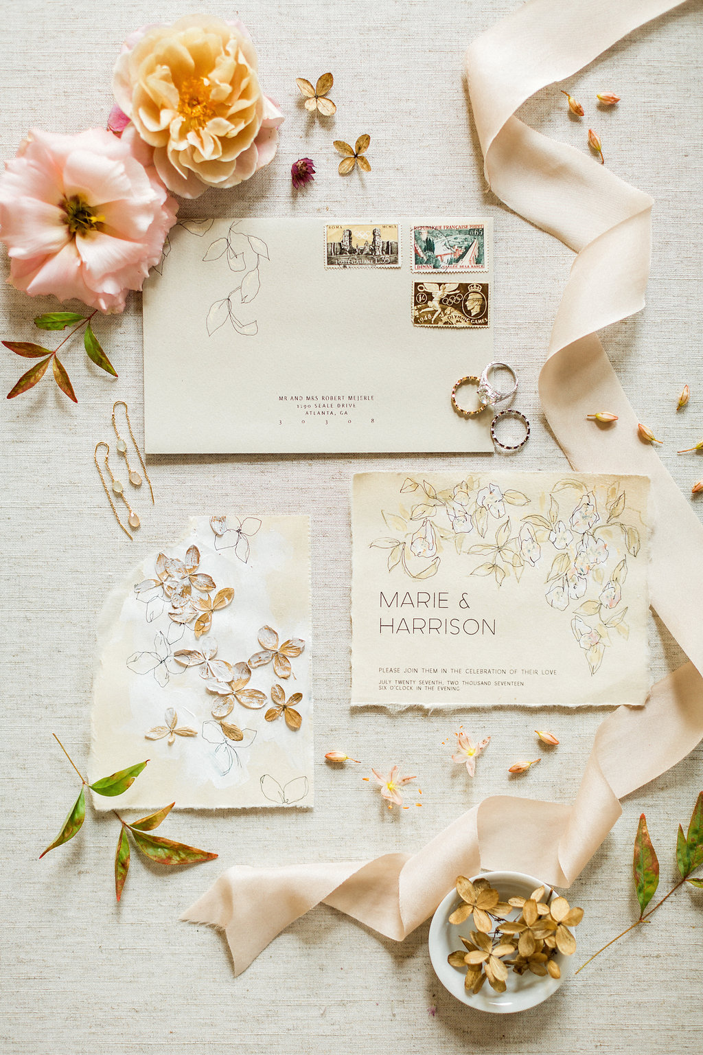 romantic old world inspired wedding invitations - https://ruffledblog.com/cloudy-day-wedding-inspiration-with-a-hand-painted-bridal-gown