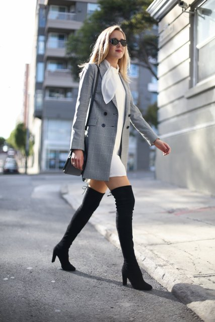 With white mini dress, black bag and black high boots