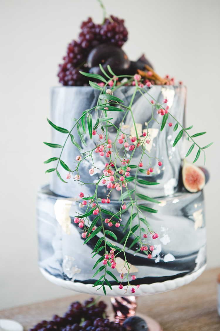 grey marbled wedding cakes - http://ruffledblog.com/fall-wedding-tablescape-with-an-unexpected-color-palette