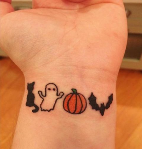 Cute tiny ghost, cat, pumpkin and bat tattoos on the wrist