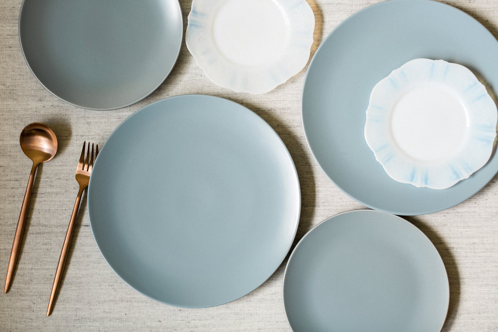 soft blue wedding plates - https://ruffledblog.com/cloudy-day-wedding-inspiration-with-a-hand-painted-bridal-gown