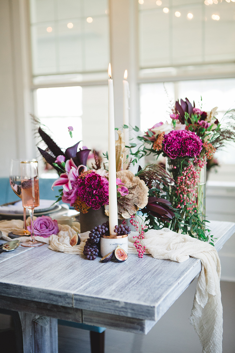 wedding tablescapes with fuchsia flowers - http://ruffledblog.com/fall-wedding-tablescape-with-an-unexpected-color-palette
