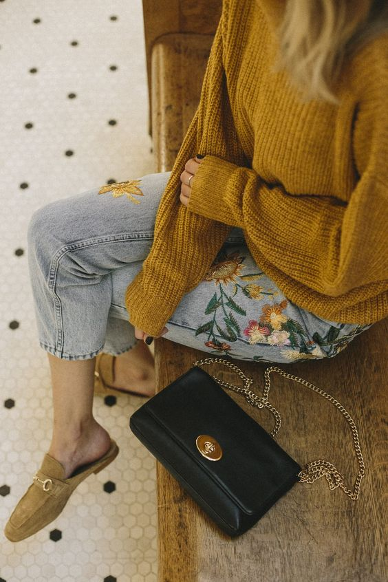 a mustard sweater, floral embroidered denim and mustard moccasins for a boho look