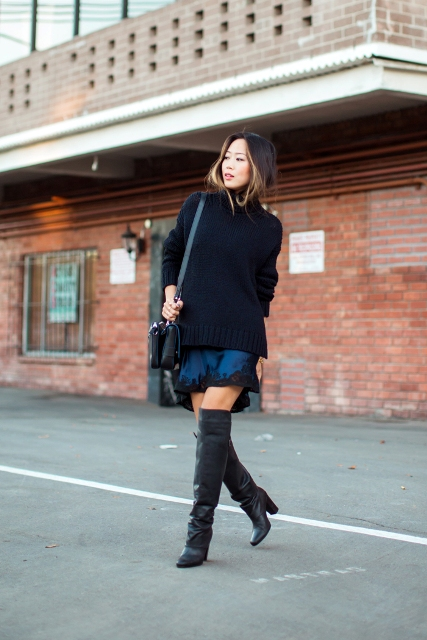 With black oversized sweater, lace dress and leather bag