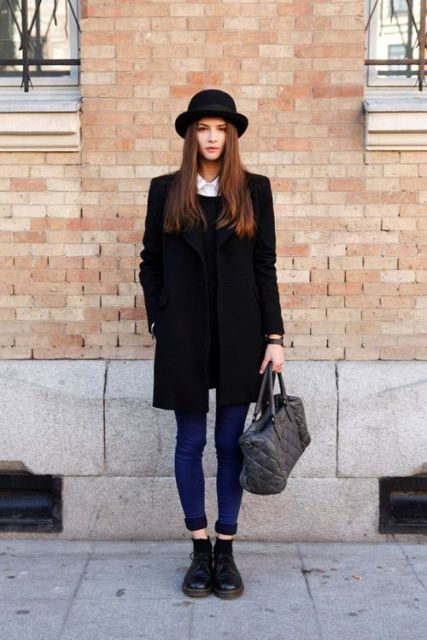 With sweater, jeans, black boots and gray bag