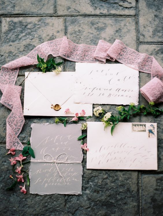 grey and cream wedding stationery suite with a raw edge looks very chic and cute