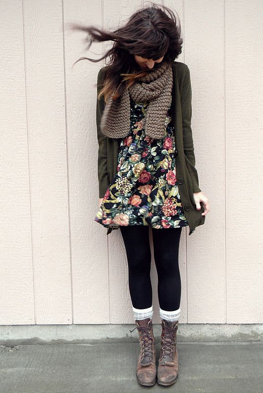a floral mini dress, black tights, tall socks and brown boots, a green cardigan and a scarf