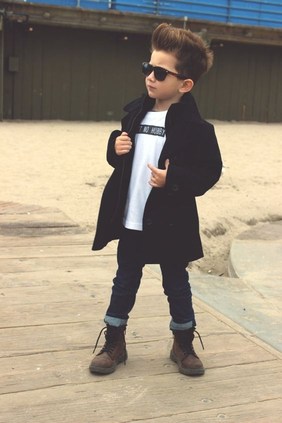 navy jeans, a white printed tee, a black coat and brown suede boots