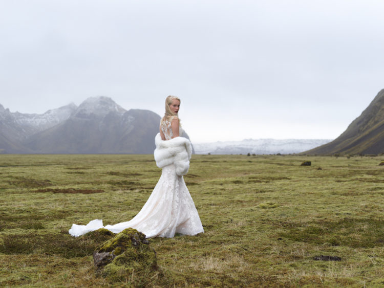 Mermaid lace wedding dress with an illusion back, no sleeves, a train and a gorgeous faux fur coverup
