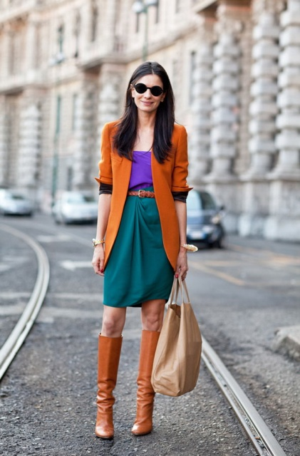 With purple blouse, green skirt, brown cardigan and belt