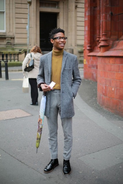 With tweed mini coat, gray trousers and black boots