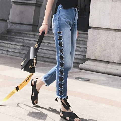 With black t-shirt, sandals and black bag