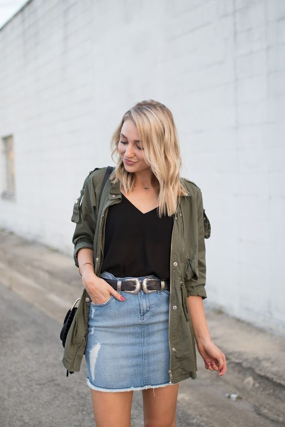 a black top, a denim mini skirt, an olive green shirt to cover up